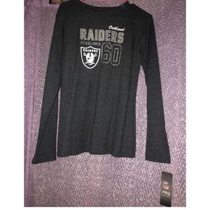 Oakland Raiders shirt.